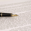 Stock Photo: Close up of a fountain pen on a sheet of paper