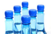 Close up of gas water bottles on a white background — Stock Photo