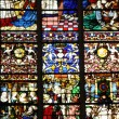 Cathedral stained glass window of Rouen in Normandy - Stock Photo