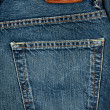 Blue jeans fabric with pocket and label — Stock Photo #10538289