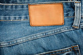 Blank leather jeans label sewed on a blue jeans — Stock Photo