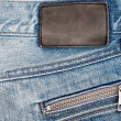 Royalty-Free Stock Photo: Blank leather jeans label sewed on a blue jeans