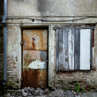 Stock Photo: Boarded up window and rusty door