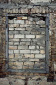Old wall with immured window — Stock Photo