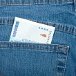 Money in pocket, blue jeans - Stock Photo