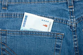 Money in pocket, blue jeans — Stock Photo