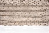 Brick wall and snow — Stock Photo