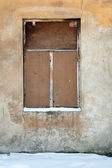 Old wall with covered window — Stock Photo
