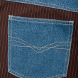 Jeans and lined brown fabric textures — Stock Photo