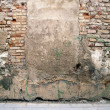 Stock Photo: Aged street wall