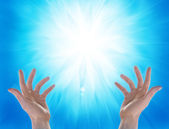Hands and sun on blu background — Stock Photo