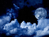 Full moon with clouds and stars — Stock Photo