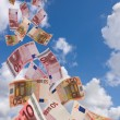 A lot of flyinq away banknote on a sky background — Stock Photo #8394950