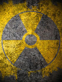 Dirty yellow nuclear warning symbol — Stock Photo