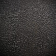 Shiny black leather background close up — Stock fotografie