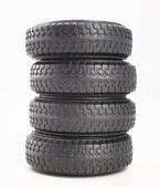 Four tires isolated on white background — Stock Photo