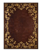 Brown leather background with golden floral decorations — Stok fotoğraf