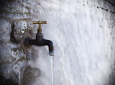 Tap on frozen wall — Stock Photo