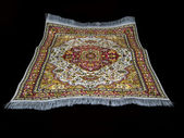 Flynig turkish carpet on black — Stock Photo