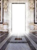 Luminous door with marble floor and angel statue — Stock Photo