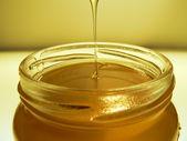 Yellow honey jar — Stock Photo