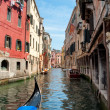 Gondola on canal between old houses at Venezia - Italy — Stock Photo