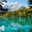 Italia - Udine - Lago di Fusine e monte Mangart with woods frame - Stock Photo