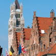 Royalty-Free Stock Photo: Notre dame Belfry and flags at Brugge - Belgium