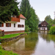 Stock Photo: View of houses and river at Slunj - Croatia
