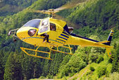 Yellow helicopter landing — Stock Photo