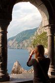 Girl on arcade at St Peters church - Porto venere - Liguria - It — Stock Photo