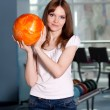 Young girl with bowling ball - Stock Photo