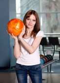 Young girl with bowling ball — Stock Photo