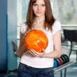 Stock Photo: Young girl with bowling ball