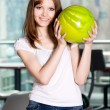 Stock Photo: Young smiling girl with green bowling ball