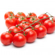 Wet Cherry tomatoes on white — Stock Photo