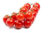 Wet Cherry tomatoes on white — Stock Photo