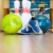 Bowling balls, shoes and pins - Stock Photo