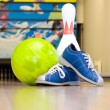 Bowling ball, shoes and pins - Stock Photo