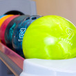 A group of colored bowling balls - Stock Photo