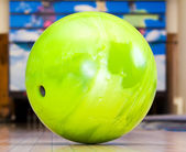Green bowling ball — Stock Photo