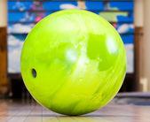 Green bowling ball — Stock Photo
