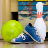 Bowling ball, shoes and pins — Stock Photo