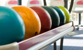 A group of colored bowling balls — Stock Photo