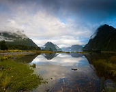 Cloudy morning at milford sound at sunrise — Stock Photo