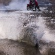 Motorcycle forcing the river — Stock Photo #8214657