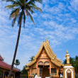 Stock Photo: Golden Buddhist temple with palm