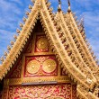 Stock Photo: Golden Buddhist temple's roof