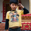 A Lao boy with superheroes - Stock fotografie