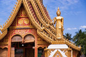 Golden Buddhist temple with carved ornaments — Stock Photo